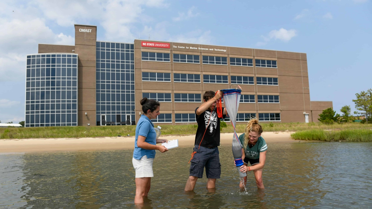 Students and an instructor sample in the sound with the CMAST building in the background