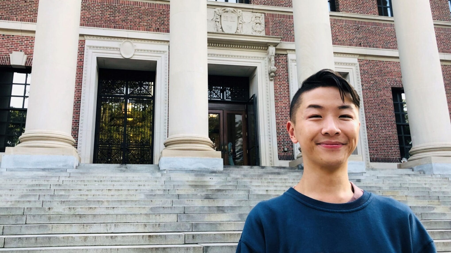 Eugene Cheung stands in front of a building.
