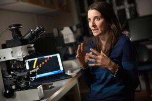 Rachel Foster, Stockholm University, with microscope