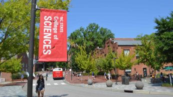 College of Sciences banner outside SAS Hall on NC State's campus